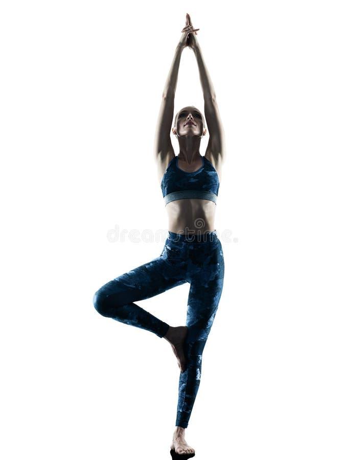 Siluetta dei excercises di yoga di forma fisica della donna fotografia stock libera da diritti