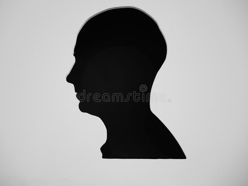 Siluetta dei profili capi dell'uomo differente fotografia stock