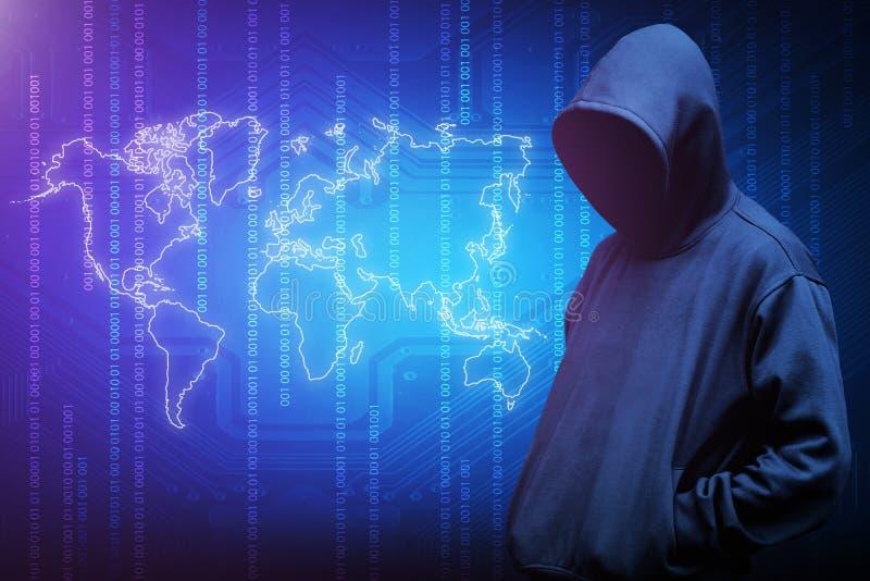 Siluetta del pirata informatico di computer dell'uomo incappucciato fotografie stock libere da diritti
