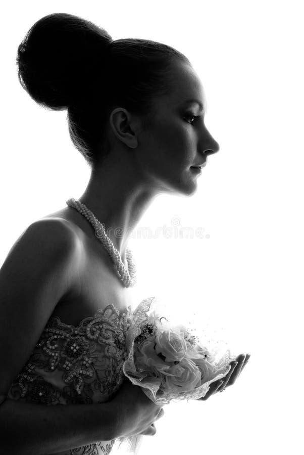 Siluetta del vestito d'uso dalla sposa immagini stock