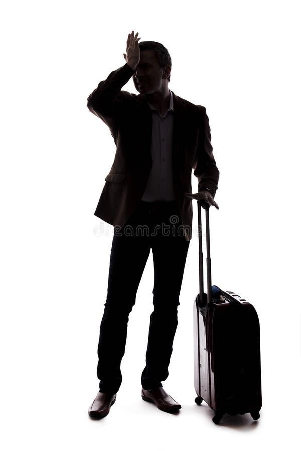 Siluetta dell'uomo d'affari di viaggio Upset al volo in ritardo o annullato fotografia stock libera da diritti