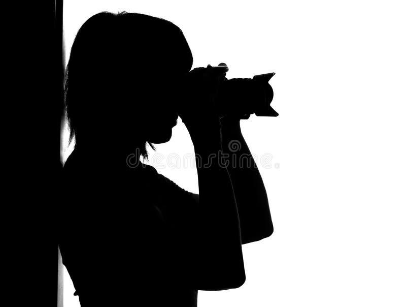Siluetta della donna con la foto fotografia stock