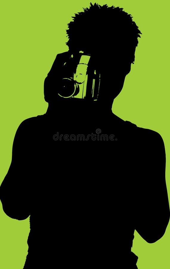 Siluetta della donna con la videocamera fotografie stock