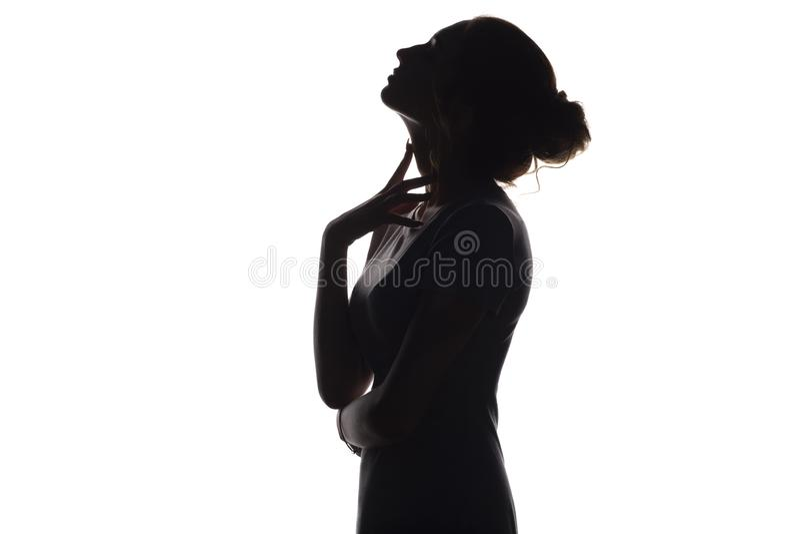 siluetta di bella ragazza, profilo del fronte della donna su fondo isolato bianco, concetto di bellezza e modo immagine stock libera da diritti