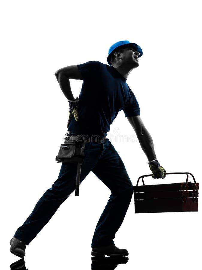 Siluetta di dolore di mal di schiena dell'uomo del lavoratore manuale fotografia stock