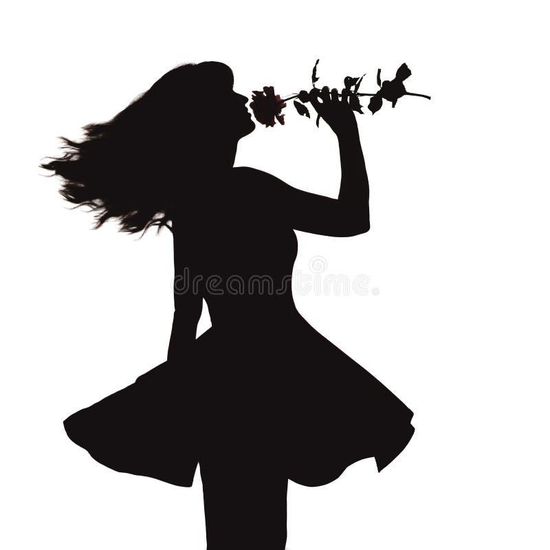 Siluetta di giovane donna elegante in un vestito e con una rosa in mani, figura della ragazza romantica con un fiore che balla da immagine stock