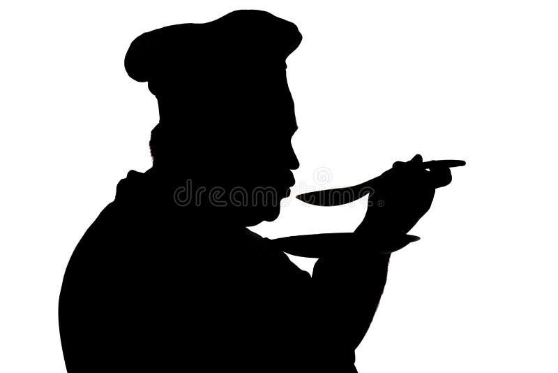 Siluetta di un piatto dell'assaggio del capo-fornello su un fondo isolato bianco, profilo di un fronte maschio in un cappello del immagini stock