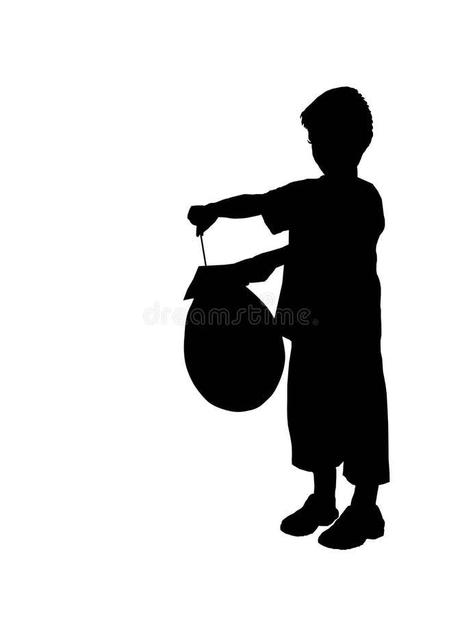 Siluetta di un ragazzo con la sfera immagine stock libera da diritti