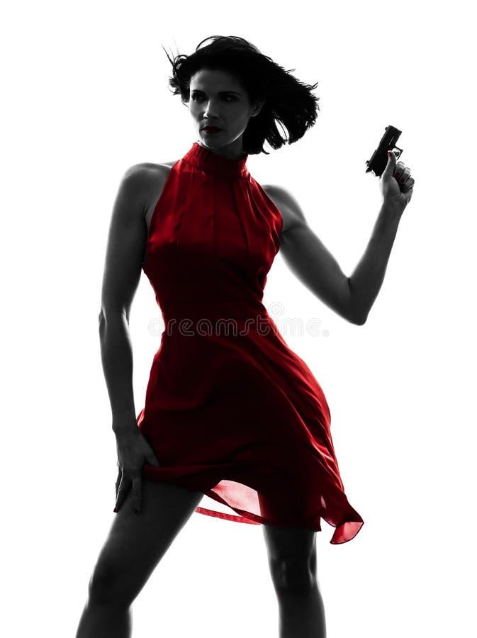 Siluetta sexy della pistola della tenuta della donna fotografie stock