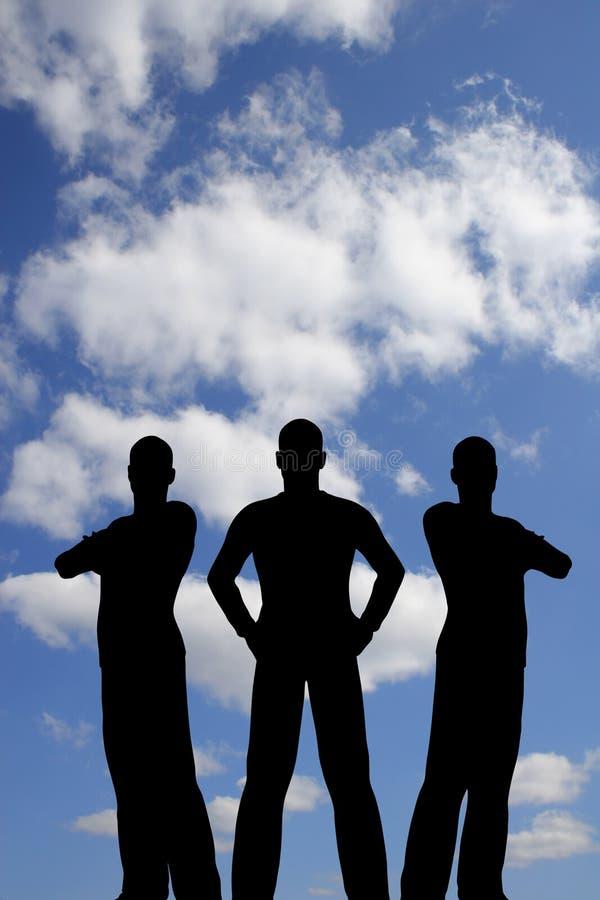 Siluetta tre sul cielo della nube illustrazione di stock