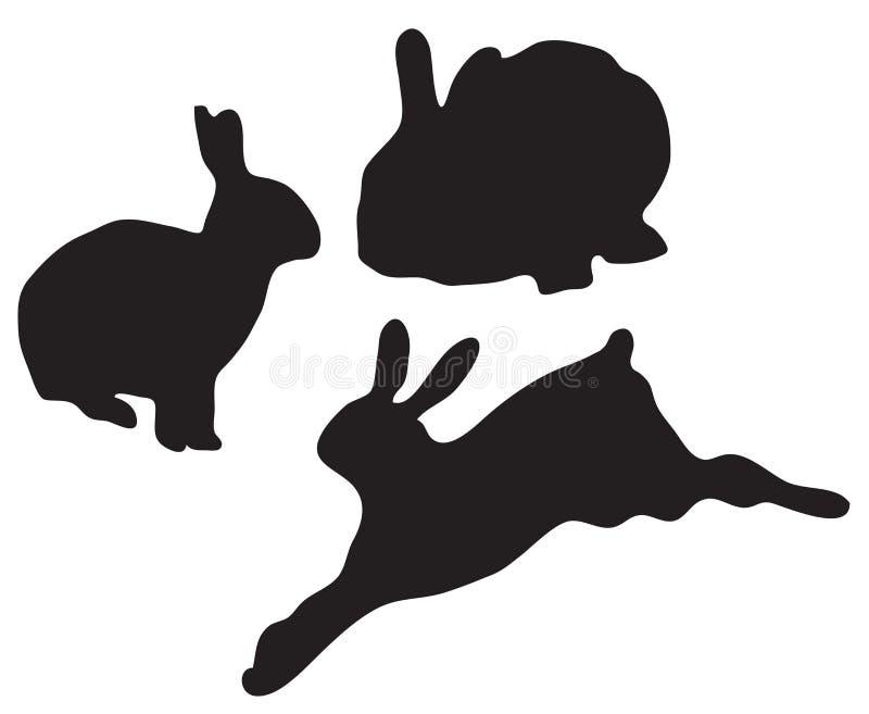 Siluette dei coniglietti di vettore isolate su fondo bianco royalty illustrazione gratis