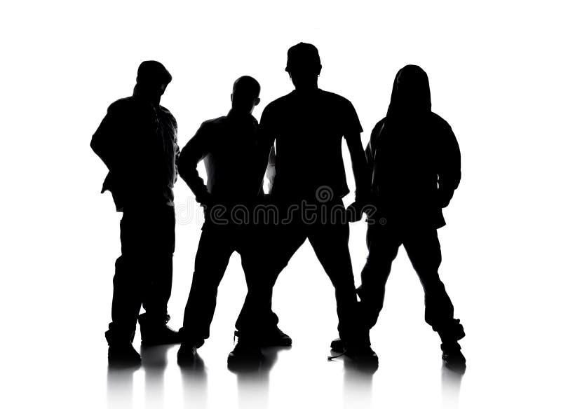 Siluette di levarsi in piedi degli uomini immagini stock libere da diritti