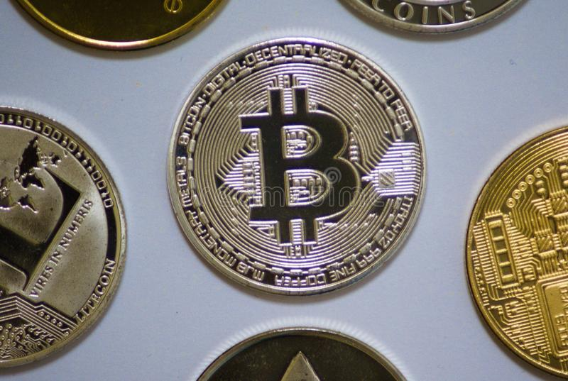 Silver and gold cryptocurrency coins stock photography