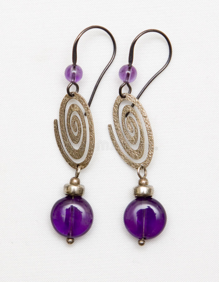 Silver. Earrings with amethyst stone stock photos