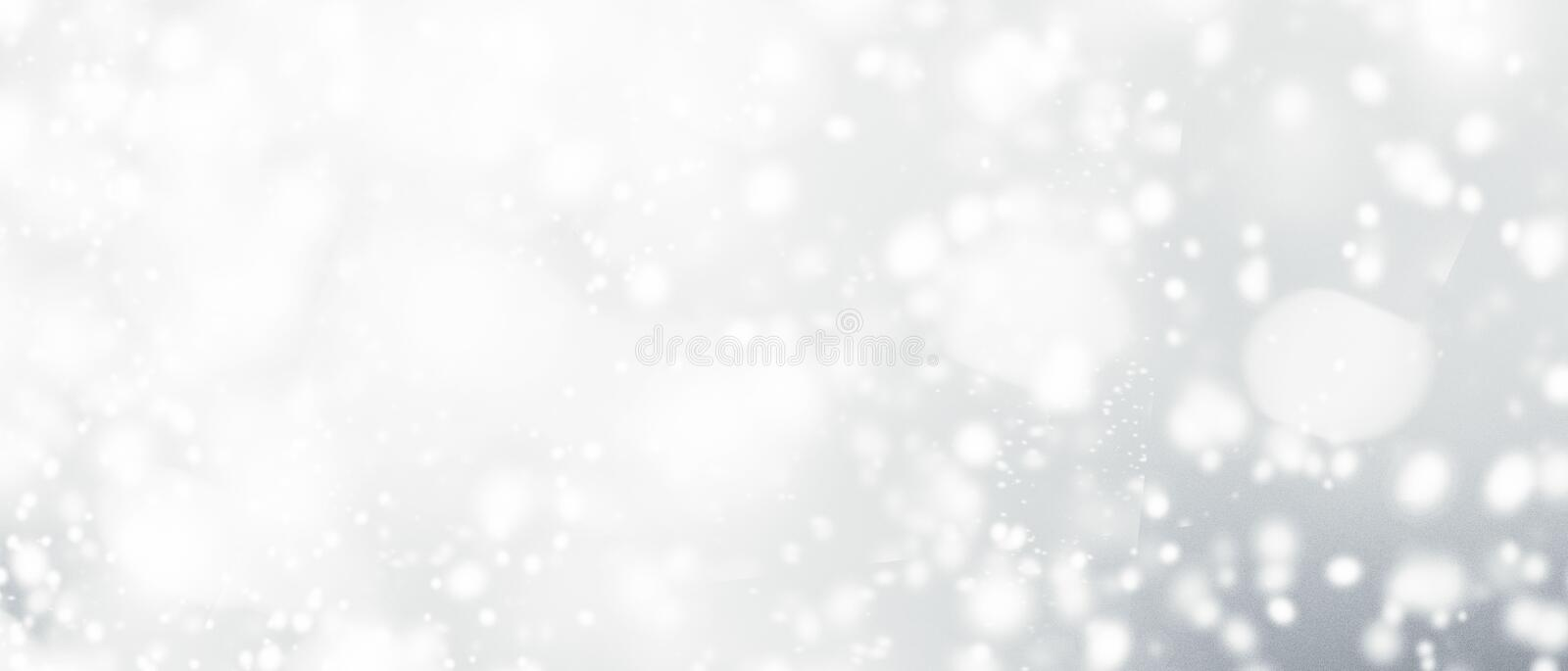 Silver abstract bokeh background with snowflake and white glitt. Ering bokeh stars. A shiny holiday card. Glowing blurred lights stock image