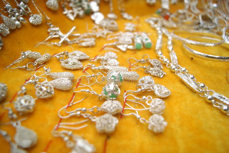 Silver Accessories. Silver jewelry close-up. This is Chinese Miao silver jewelry royalty free stock images