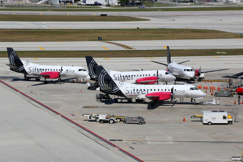 Silver Airways Saab 340 airplanes Fort Lauderdale airport. Fort Lauderdale, United States - February 17, 2016: Silver Airways airplanes at Fort Lauderdale royalty free stock image