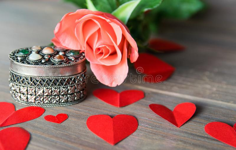 Silver antik casket with flower and red paper hearts stock image