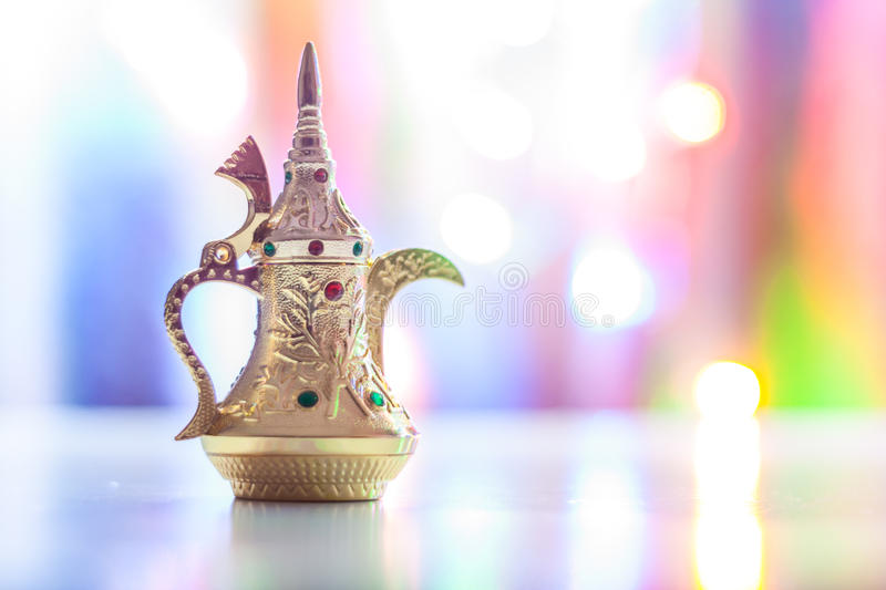 Silver Arabic Coffee pot in colorful illuminated background. Silver Arabic Coffee pots in colorful illuminated background. Ramadan and Eid concept background stock photography