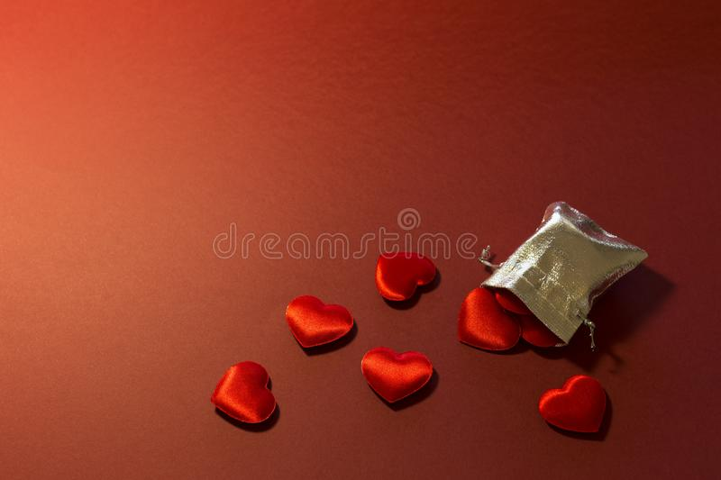 Silver bag filled with love and romance royalty free stock image