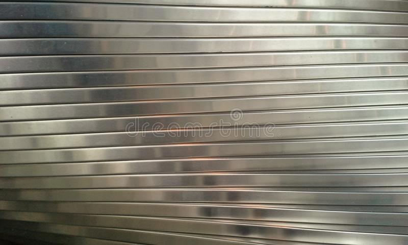 Silver Bars. Offset silver bars twisting in a spiral stock photography