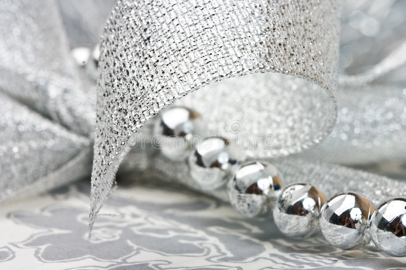 Silver beads and ribbon stock image