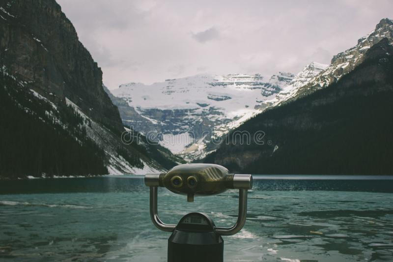 Silver And Black Robot Near Body Of Water And Mountains During Day Free Public Domain Cc0 Image