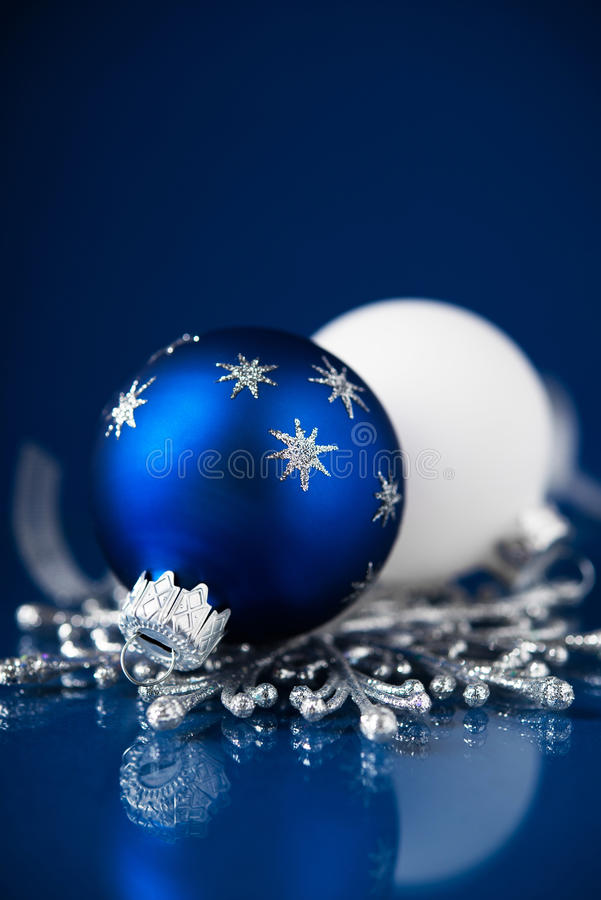 Silver and blue christmas ornaments on dark blue background. Merry christmas card. Happy holidays royalty free stock photos
