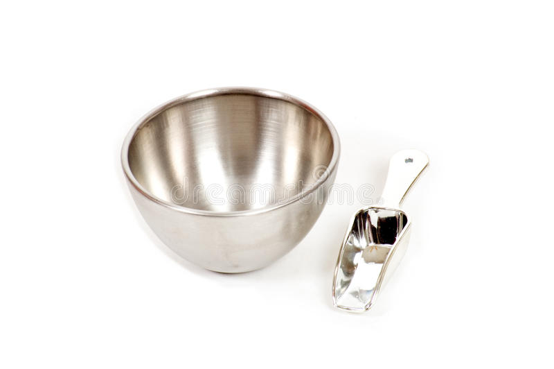 Silver bowl with measuring scoop stock photo