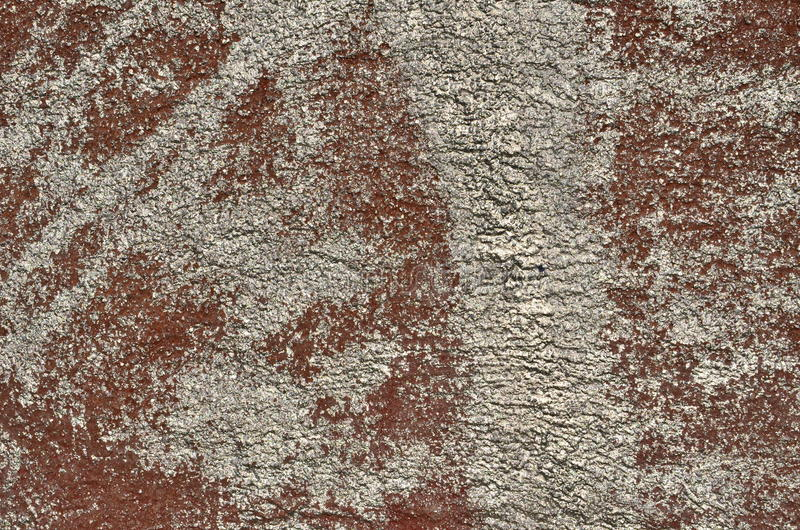 Silver and brown colors. Plastered wall airbrushed with brown and silver paint stock photo