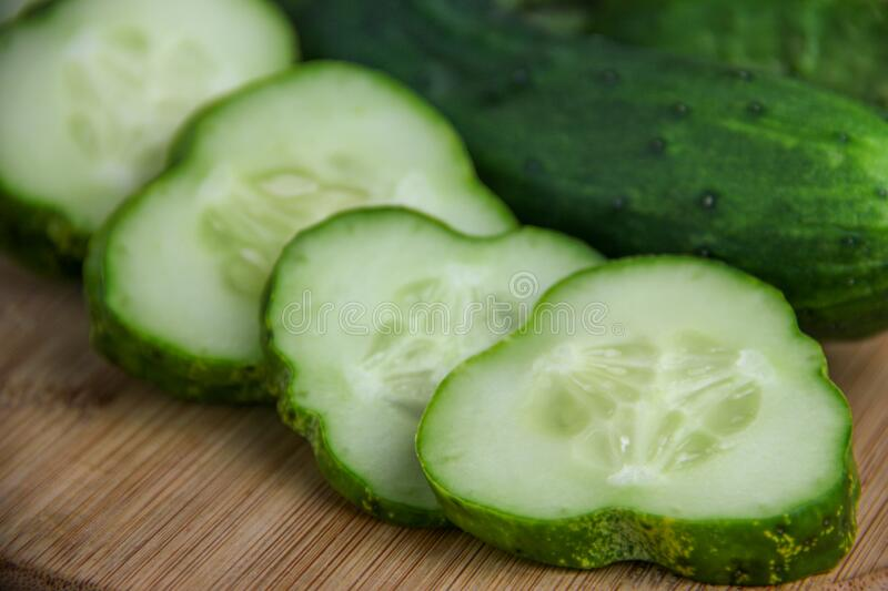 Cucumbers and Cucumber Slices royalty free stock photography