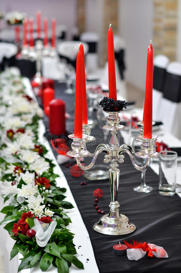 Silver candle holder on wedding table. Luxury wedding table decoration with silver candle holder royalty free stock images