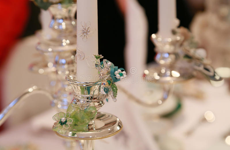 Silver candle stand. On the table stock image