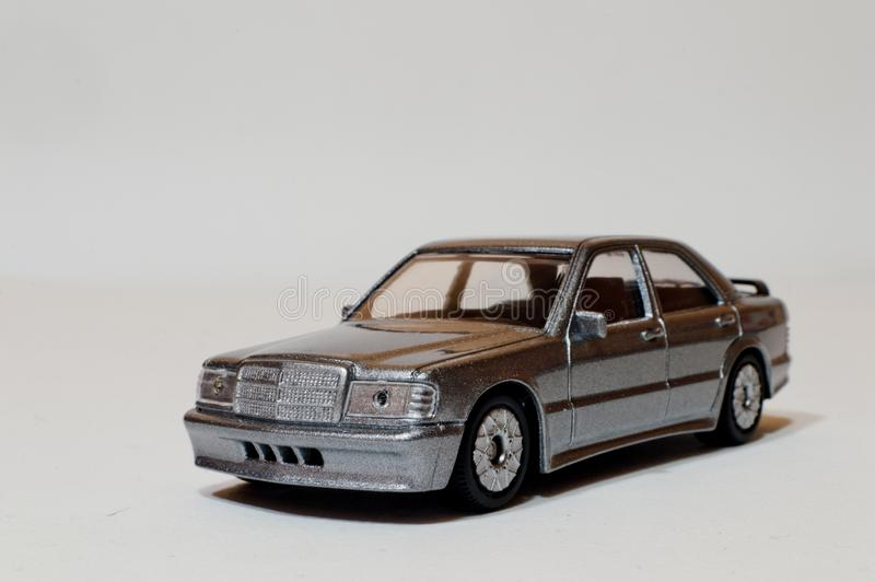 1:54 Mercedes 190E. A silver 1:43 car, a die cast model of a Mercedes 190 2.3 E. This sedan with Ford`s Sierra Cosworth and BMW`s M3, was one of a new generation stock photography