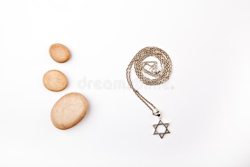 Silver chain Davids star stones white background royalty free stock images