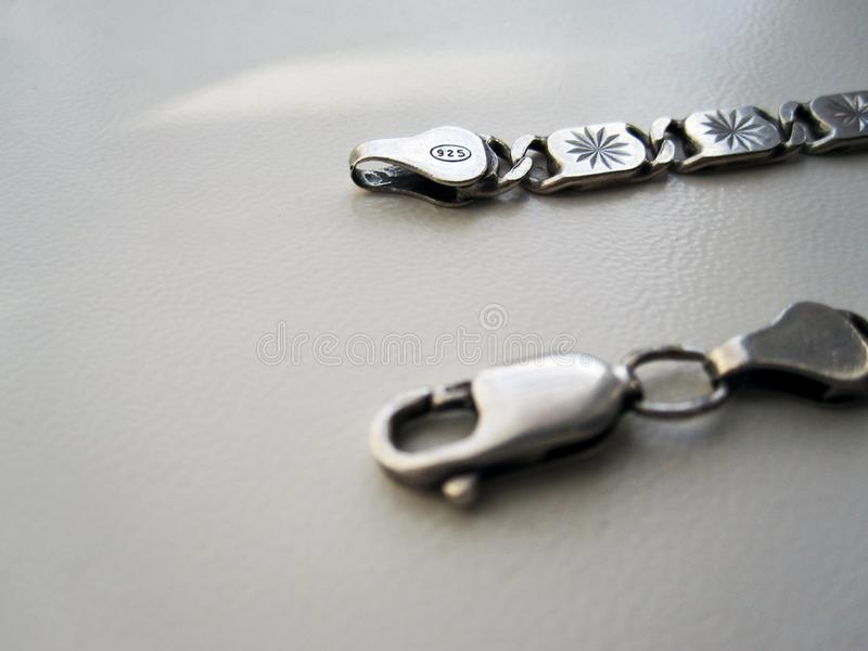 Silver Chain Hook. This photo shows a silver chain hook 925 sample on a gray background stock photo