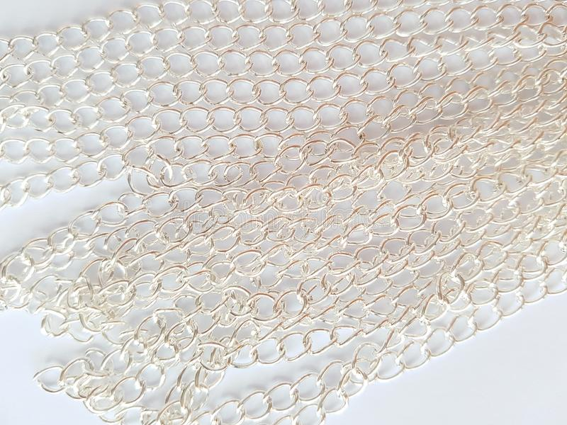Chain links. Silver chains on a white background. Background, texture, close-up. Chain links stock photos