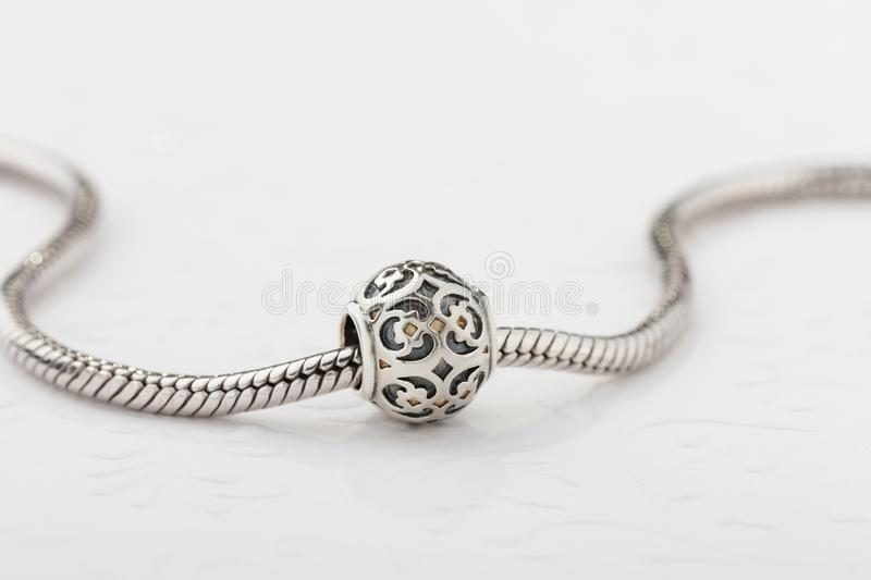 Silver charm bead with ornament for chain bracelet. Product concept for jeweler stock image