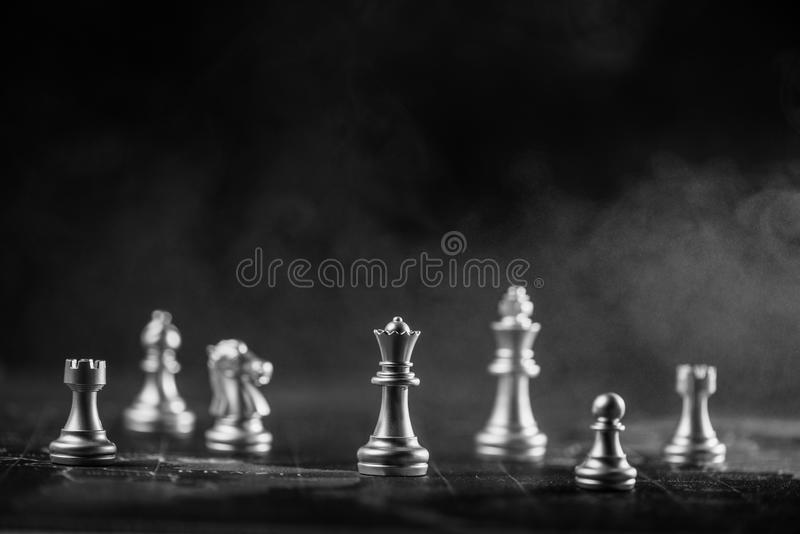 Silver chess on world map with smoke background stock images