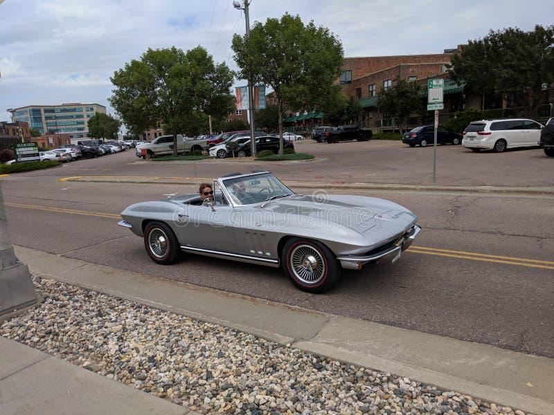 Chevy & x27;Vette Convertible. Silver Chevrolet Corvette Convertible royalty free stock photos