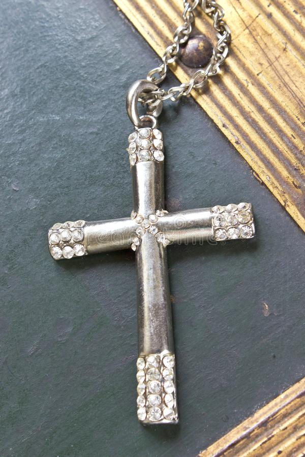 Silver christian cross on vintage background stock image