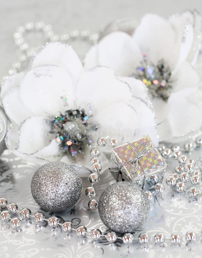 Silver Christmas. Christmas ornaments in silver and white tone royalty free stock images