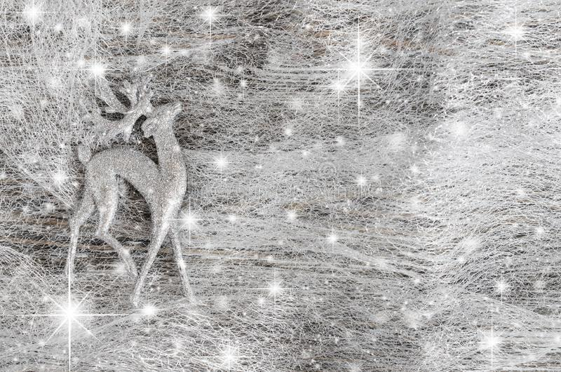 Silver Christmas background. Decorative deer and snowflakes stock photography
