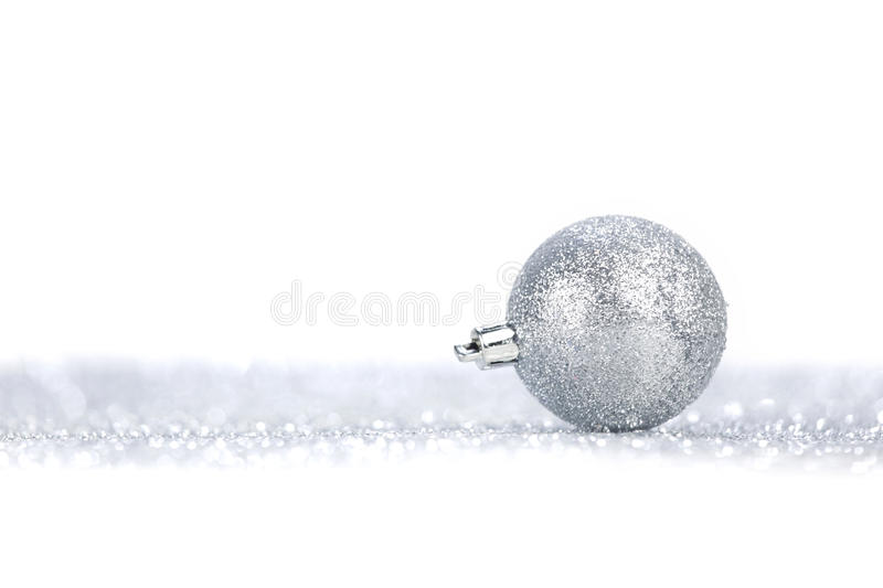Silver christmas ball. On glitter background with white copy space royalty free stock photos