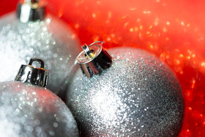 Silver christmas balls on glitter background royalty free stock image