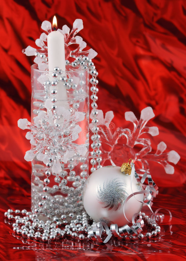 Silver christmas decoration on red background stock images