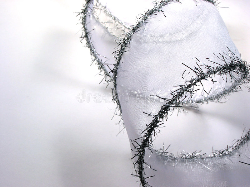 Silver Christmas ribbon on white stock photography