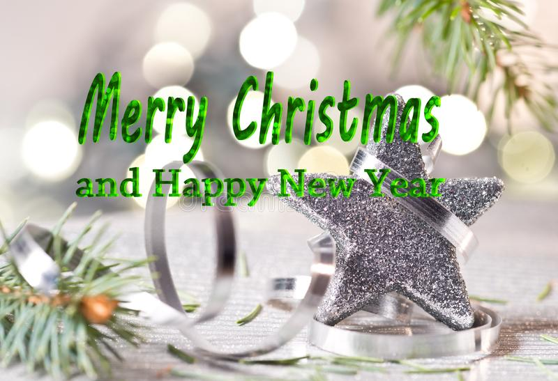 Silver Christmas star with text Merry Christmas. And happy new year stock photo