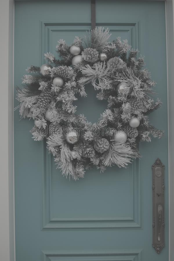 Silver christmas wreath on blue dooor stock photos