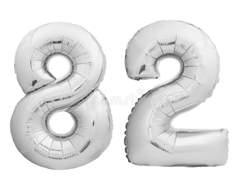 Silver chrome number 82 eighty two made of inflatable balloon on white. Silver chrome number 82 eighty two made of inflatable balloon isolated on white stock image
